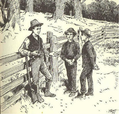 Three boys standing by a fence, one older than the others.